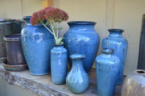 Horticulturist and local potter, Jimmy Richardson of Hemphill Pottery, creates unique stoneware pottery with a wood ash glaze for retail at Grass Root Gardens.  - Buy Haywood Photo