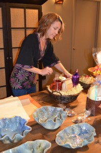 Owner, Amy Bennington, prepares a uniquely local gift basket.